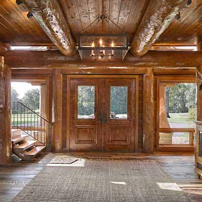 Handcrafted log home entryway