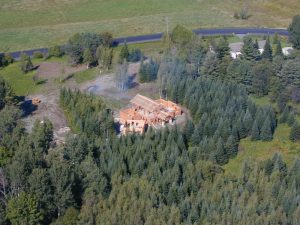 aerial view of log and timber home under construction
