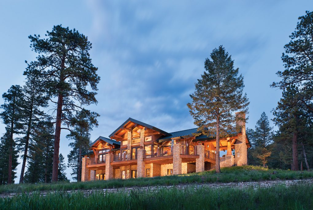 Log home with defensible space landscaping