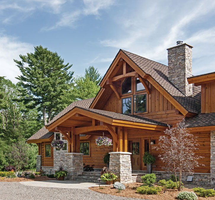 Hybrid home with milled logs and timber framing