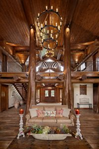 flared cedar posts enhance handcrafted log home