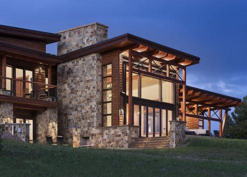 mountain-modern-timber-frame-home-twilight-exterior-precisioncraft