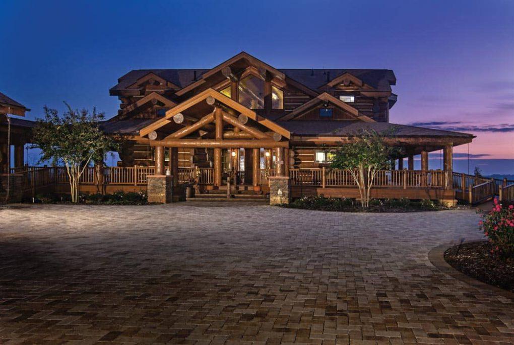 handcrafted log home at dusk
