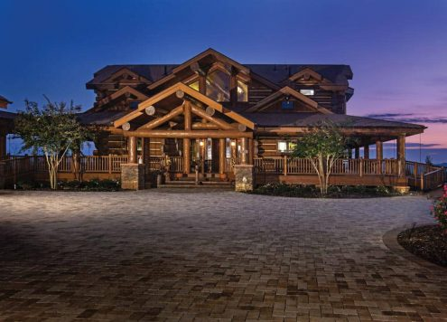 handcrafted log home at dusk