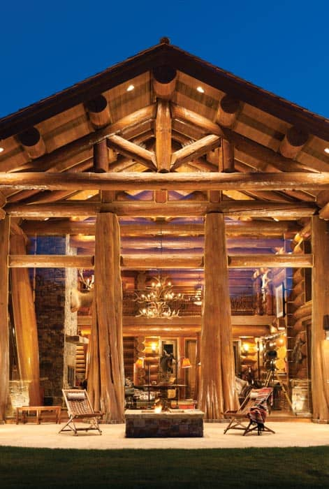 tapered log at entry of handcrafted log home in wyoming