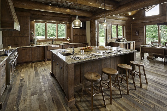 kitchen island with breakfast bar in a log home